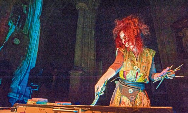 Multi-media artist Maria Rud creating images in Edinburgh's St Giles Cathedral.