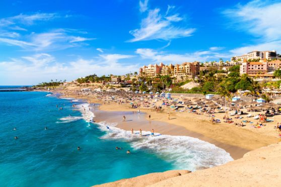 Many are starting to dream of going abroad. Image shows El Duque beach and coastline in Tenerife
