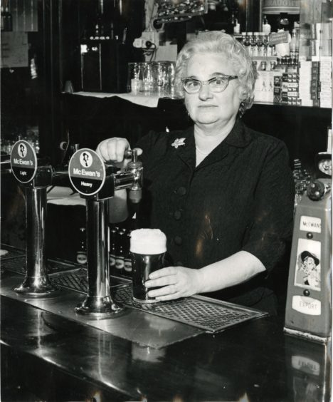 Legendary Dundee barmaid Isobel Mennie pouring a pint in 1972 in Speedwell Bar, Perth Road