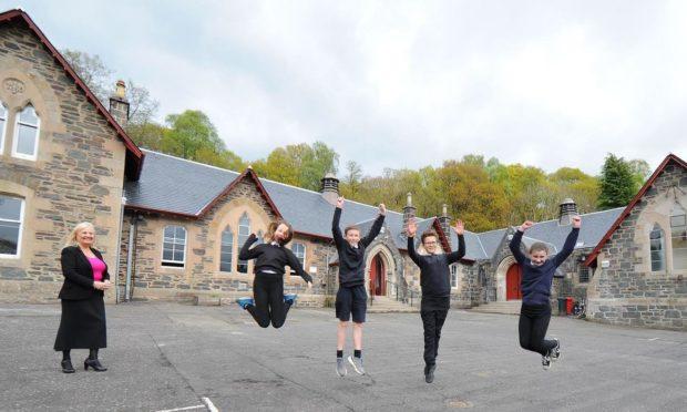 Children outside refurbished Aberfoyle Primary School alongside headteacher Maxine Barwick