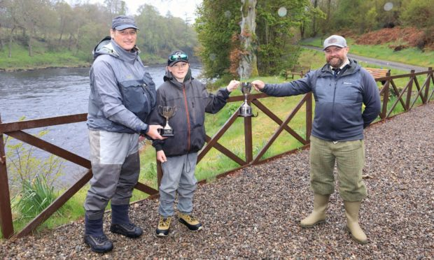 Liam Crees with his father Steve Crees and TGA chairman Cohn O'Dea. Picture: Phil Hannah.