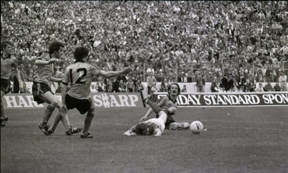 Iain Phillip brings down Bobby Russell in the United box with just seconds to go in the 1981 Scottish Cup Final at Hampden.
