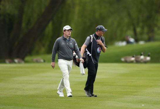 Robert MacIntyre and caddie Mike Thomson.