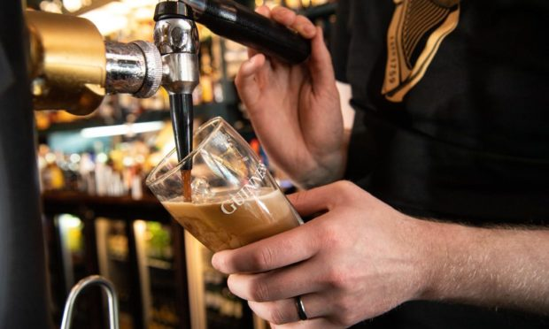A pint of Guinness being poured as pubs reopen following the winter lockdown.