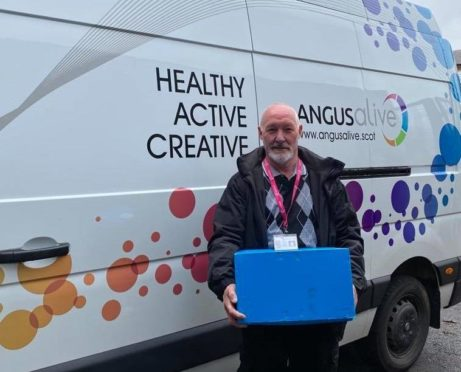 Alan Martin of Angus Alive with a selection of books for home delivery.