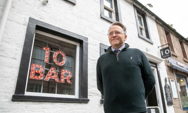 Courier News - Angus - Graham Brown story - CR0028352 - Bar 10 and Giddy Goose, Forfar. Cafe 10 Bar on Forfar has been given a 2am licence in breach of Angus Council licensing policy. Picture shows; Alan Hampton, Cafe 10 Bar, Castle Street, Forfar, 20th May 2021, Kim Cessford / DCT Media.