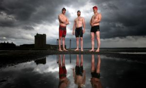 Intrepid Yeabba swimmers pose up in front of Broughty Ferry Castle in 2017.