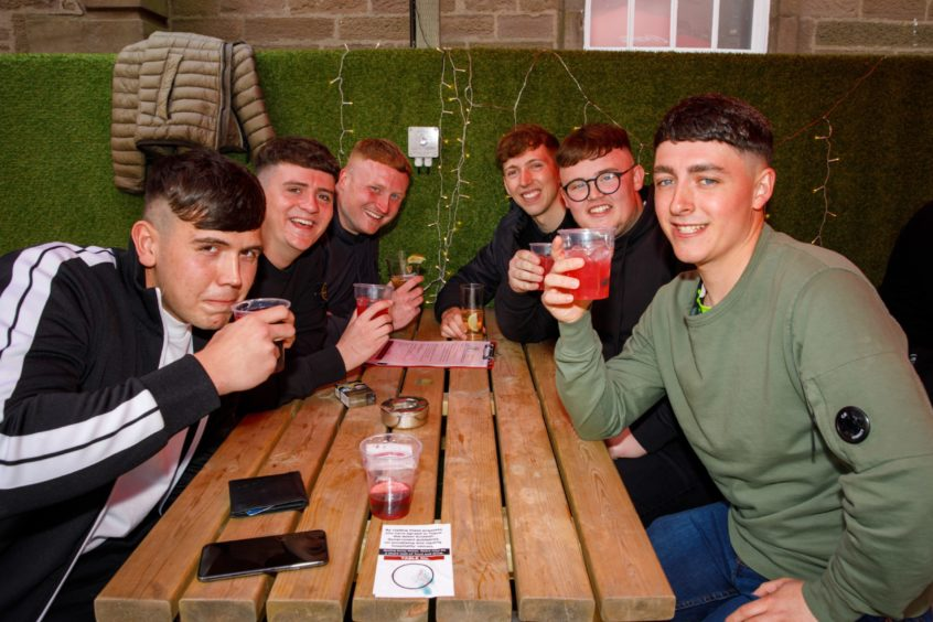 Guys out enjoying a drink at The Casa on Perth Road, Dundee.