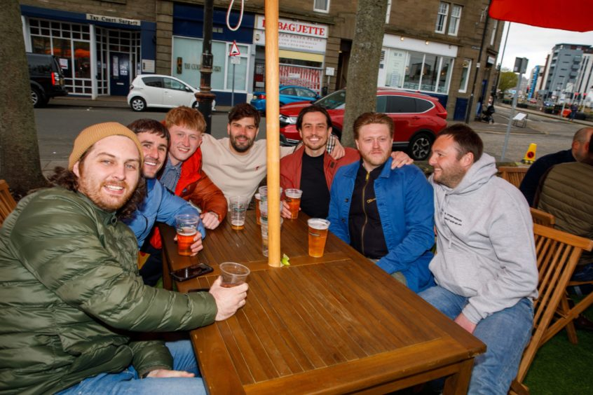 Customers enjoying a drink at The West House on South Tay Street.