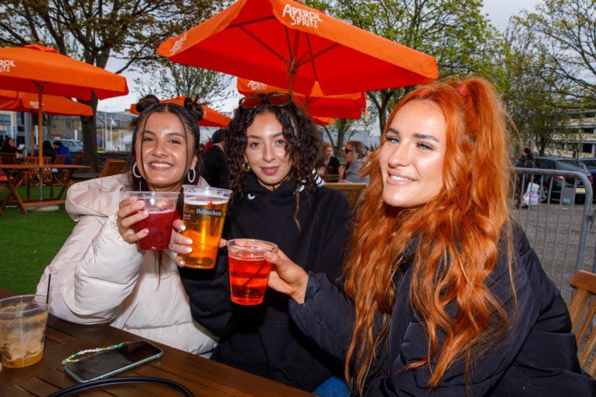 From left: Priya Ferguson, Amina Benmalek and Niamh Kilcullen enjoy a drink at The West House on South Tay Street.
