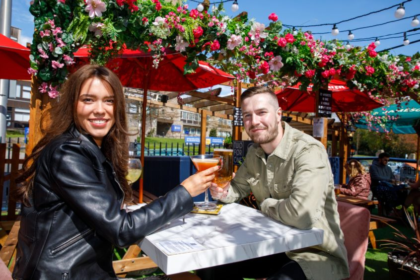 Allana Logan and Kyle Anderson enjoy a drink at the Giddy Goose on Perth Road, Dundee.