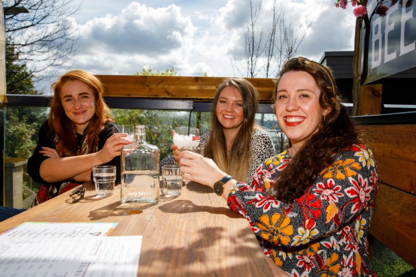 From left: Emma Sullivan, Erin McCann and Esther McNeill enjoy a drink at the Giddy Goose on Perth Road.