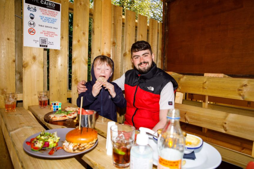 Dylan Nicol and his son, Harley Jack Crawford, enjoy a drink and bite to eat at the 172 at The Caird on Perth Road, Dundee.