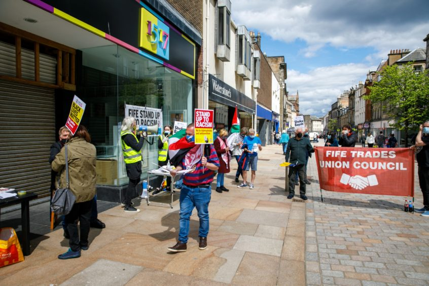 A protestor in Kirkcaldy, showing his support following the death of Sheku Bayoh, left.