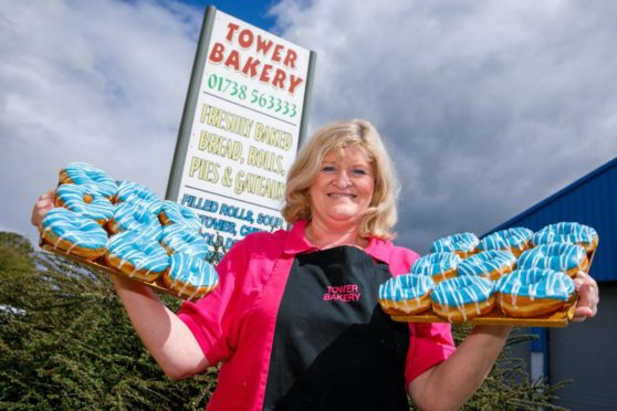 Courier-James Simpson- St Johnstone Doughnuts- CR0028275- Perth-Picture shows: Angela McKinnon of the Tower Bakery in Perth who have been inundated with requests for St Johnstone donuts ahead of their Scottish Cup Final clash with the Hibs this weekend.  18/05/21-Kenny Smith/ DCT Media