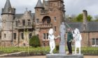 Artist Mick Peter unveils one of a series of new sculptures at Hospitalfield Arbroath ahead of the public opening of the new gardens, glasshouse cafe and restored Fernery.