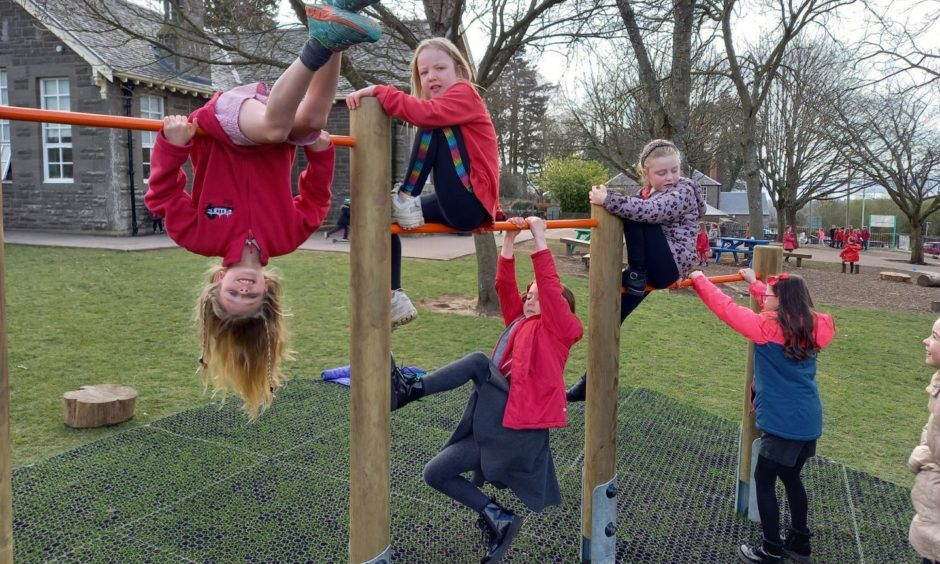 Liff Primary pupils on their new play equipment.