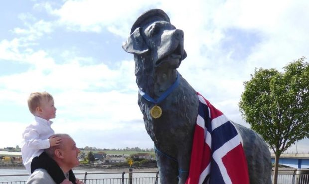 Ian Black and grandson Lucas from Montrose at the Bamse statue.