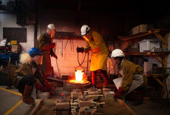 Artists at the Scottish Sculpture Workshop melting and pouring bronze for the institution's 40th anniversary.  Pictures by JASON HEDGES