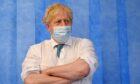 Prime Minister Boris Johnson during a visit to Colchester Hospital in Essex in May.
