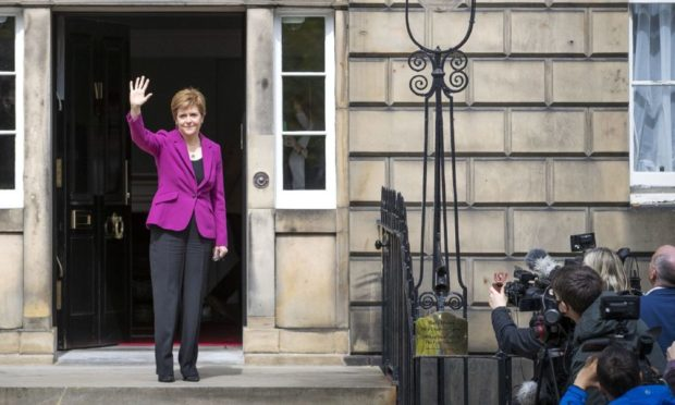 Scottish First Minister and SNP leader Nicola Sturgeon on the steps of Bute House in Edinburgh after the SNP won a fourth victory in the Scottish Parliament election. Picture date: Sunday May 9, 2021. PA Photo. The SNP fell one seat short of an overall majority in the Scottish parliament elections, securing 64 seats, but the final result still leaves Holyrood with a pro-independence majority. See PA story POLITICS Elections Scotland. Photo credit should read: Jane Barlow/PA Wire