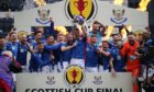 St Johnstone's Jason Kerr lifts the trophy after the final whistle during the Scottish Cup final match at Hampden Park, Glasgow. Picture date: Saturday May 22, 2021. PA Photo. See PA story SOCCER Final. Photo credit should read: Andrew Milligan/PA Wire. RESTRICTIONS: Use subject to restrictions. Editorial use only, no commercial use without prior consent from rights holder.