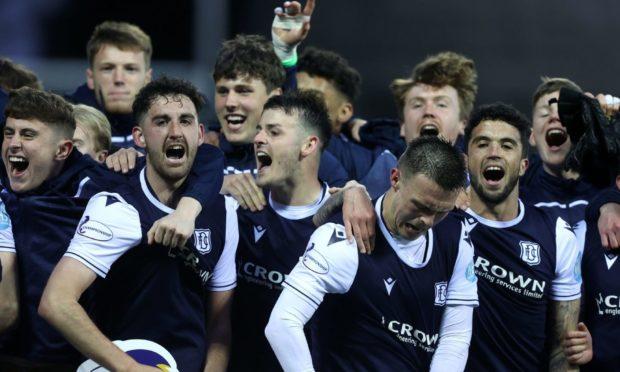 Dundee stars celebrate promotion.