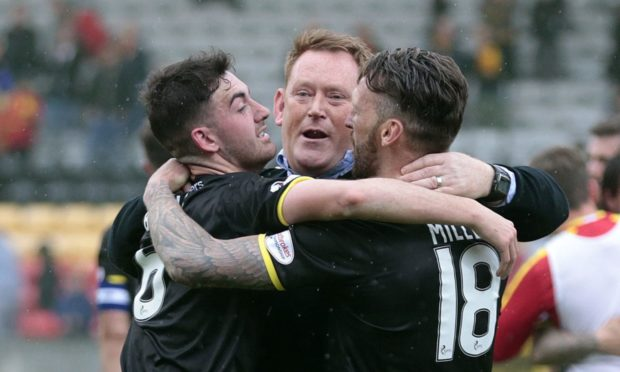 Livingston's Shaun Byrne (left) and Lee Miller with manager David Hopkin celebrate promotion with Livingston.