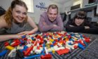 Kingdom FM DJs Gemma McLean, Dave Connor and Vanessa Motion will settle the argument that Lego is the most painful thing to stand on by walking across broken glass.