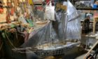 Metal model of the schooner Isabella under construction at the workshop of the 'Stonehaven Banksy'.
