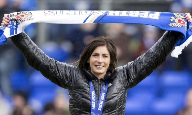 Eve Muirhead shows her football colours.