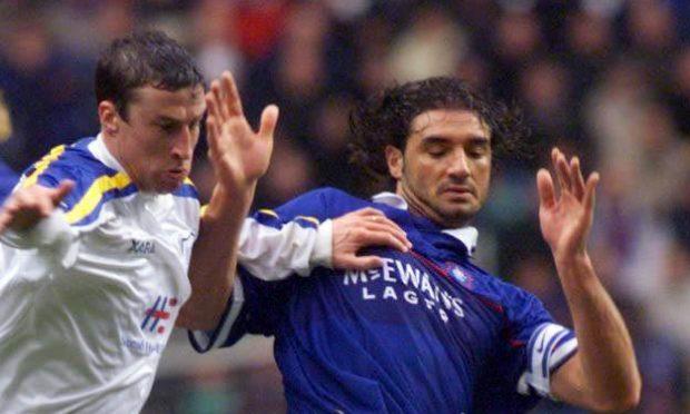 Paul Kane grapples with Lorenzo Amoruso in 1999.