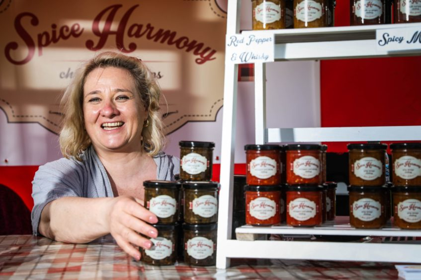 Dani Mather of Spice Harmony restocks the shelves after a busy morning.