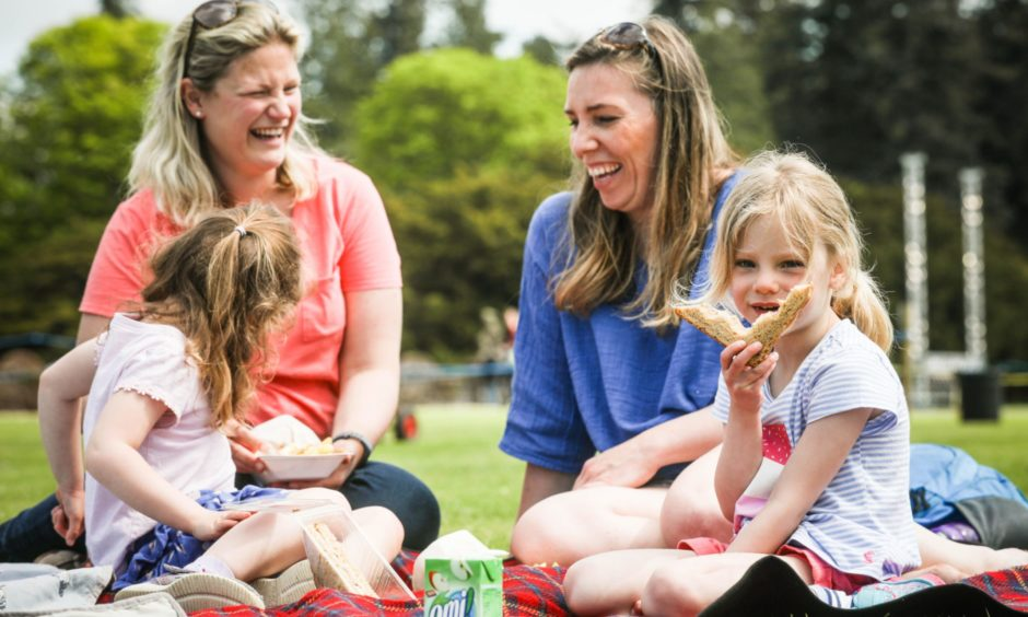 Suzannah Hopkinson, 5, and Flossie Moffat, 5, with Gemma Scott (back left) and Calli Hopkinson (back right) enjoying their picnic.