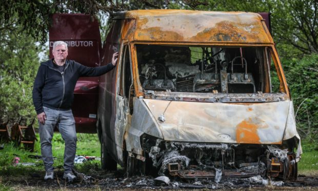 The Courier, CR0028349, News, Jimi Simpson story, David Baikie, the chairman of Tayport Football Club is speaking about on-going anti social problems at the ground, including a van that was torched over the weekend. Picture shows; David Baikie, the chairman of Tayport Football Club, with the van which was set alight on the grounds. Thursday 20th May, 2021. Mhairi Edwards/DCT Media