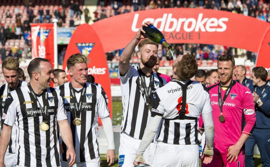 Shaun Rooney celebrating with his Dunfermline team mates as they win Scottish League 1