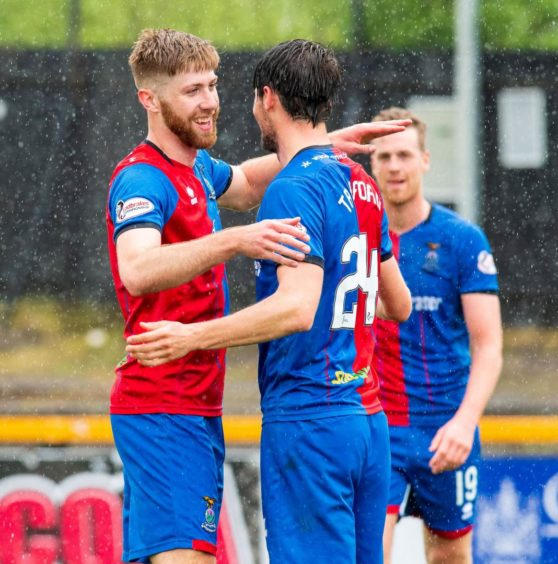 Shaun Rooney celebrating a goal for Inverness with his team mate Charlie Trafford