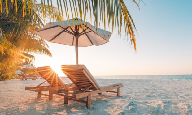 Beautiful beach. Chairs on the sandy beach near the sea. Summer holiday and vacation concept for tourism. Inspirational tropical landscape; Shutterstock ID 633002651; Purchase Order: Health and wellbeing team; Job: How to go on holiday safely; d2b53d12-abac-4853-a82c-4e3e9b3a9542