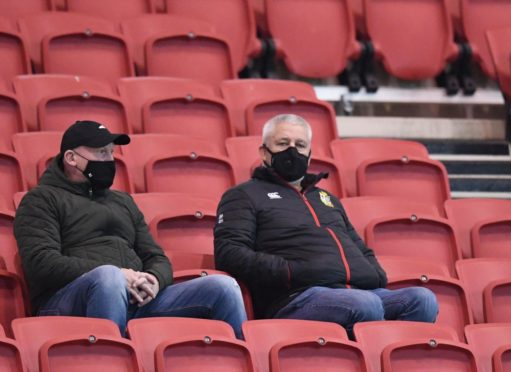 A familiar sight these last few months - a bemasked Warren Gatland watching a game, this time at Bristol...