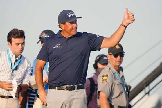 Phil saved his 1287th thumbs up of the weekend for when he went to collect the PGA Championship trophy.