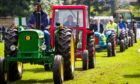 GOOD OLD DAYS: The popular vintage tractor parade in main arena at South Inch.