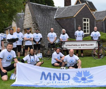 team Chivas Brothers at Strathisla Distillery in Keith after their 200-mile cycle from Dunbarton for MND Scotland.