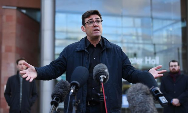 Andy Burnham, mayor of Greater Manchester, addresses the media