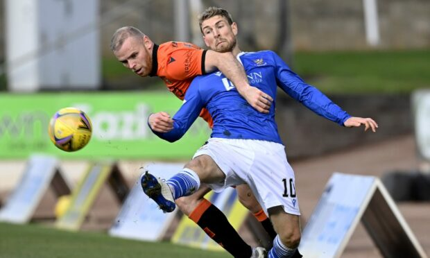 Dundee United defender Mark Connolly in action against St Johnstone's David Wotherspoon last season.