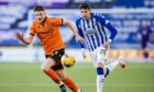 Dundee United fledgling Kerr Smith tracks Kilmarnock's Kyle Lafferty in one of his five appearances last season.