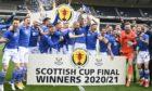 St Johnstone Captain Jason Kerr lifts the Scottish Cup trophy .