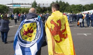Scotland fans draped in flags.