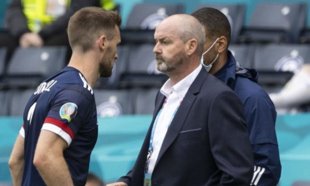 Steve Clarke must leave Stephen O'Donnell out of his team at Wembley.