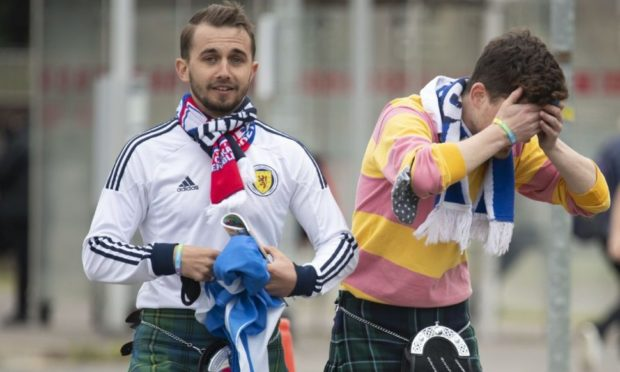 Scotland fans look dejected as they leave Hampden following their 2-0 Euro 2020 defeat to the Czech Republic.