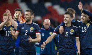 The Scotland players celebrate their draw.